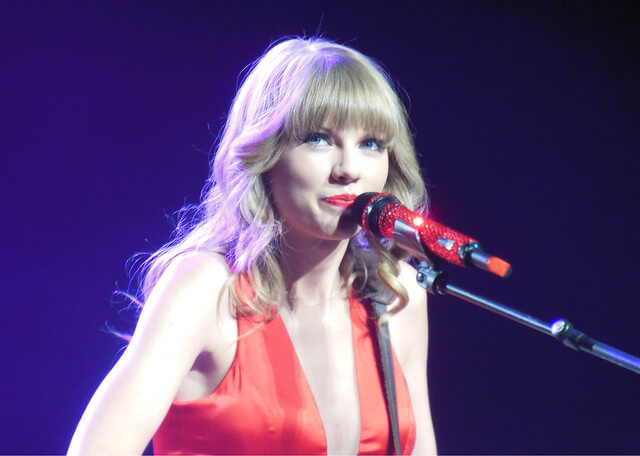 """Big Machine's name says it all """"Taylor Swift 2013 RED tour"""" by Jana Beamer licensed under CC BY 2.0"""
