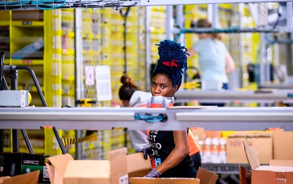 Amazon's benchmark shipping speed has a human cost. JOHANNES EISELE/AFP via Getty Images
