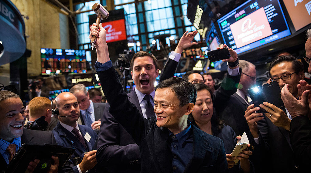 Founder and Executive Chairman of Alibaba Group Jack Ma celebrates as the Alibaba stock goes live during the company's initial price offering (IPO) at the New York Stock Exchange.