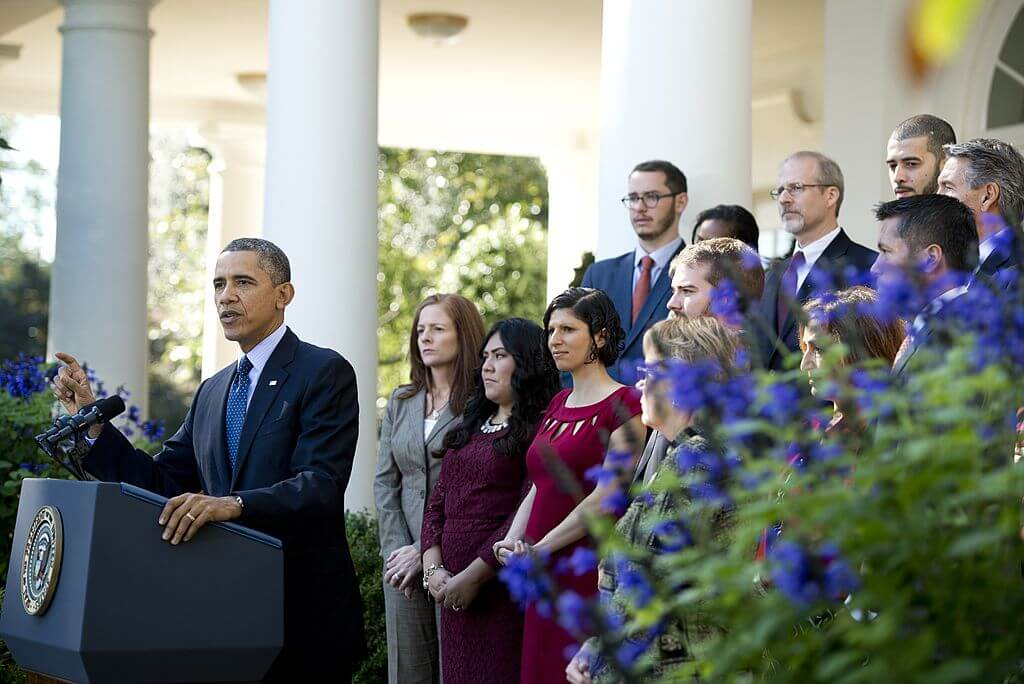 US President Barack Obama speaks about the Affordable Care Act, the new healthcare laws, alongside healthcare professionals and people affected by the new legislation, in the Rose Garden of the White House.