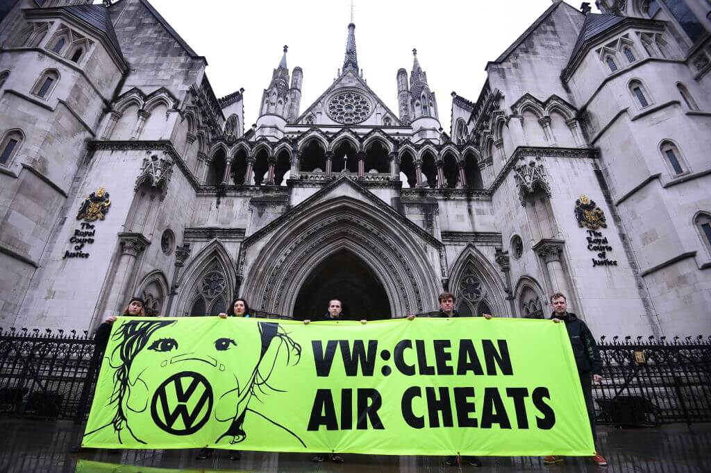 Greenpeace activists hold up a banner outside the Royal Courts of Justice in London, as Volkswagen drivers take their emissions scandal claims to the High Court.