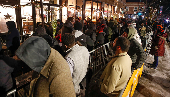 Customers line up outside of an Illinois dispensary