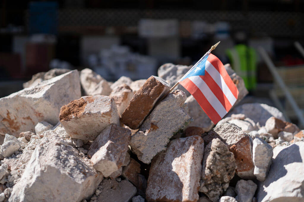 Puerto Rican flag in rubble