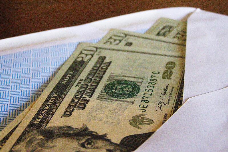 tip money in an envelope