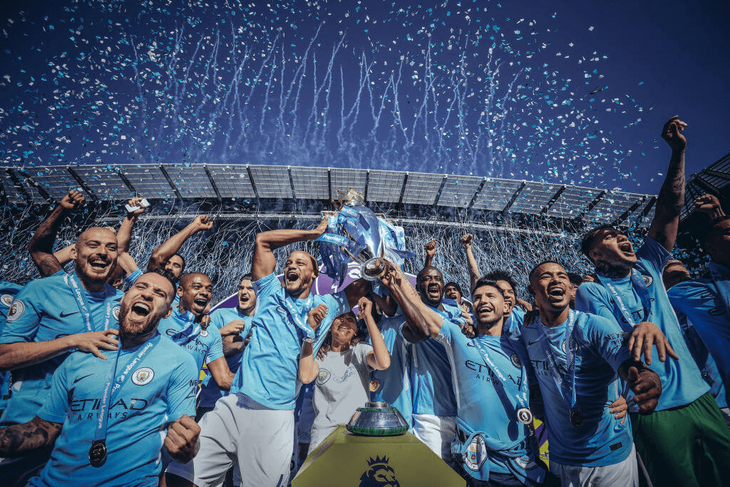 Man City football team celebrate in photograph